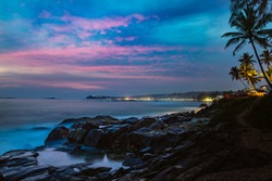 Beautiful night landscape tropical rocky beach. Sri Lanka.