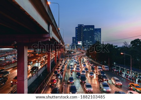Beautiful night time image of traffic on road with moving cars lights, Bangkok Thailand.