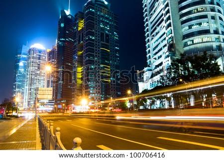 beautiful night view of shanghai finance and trade zone - stock photo