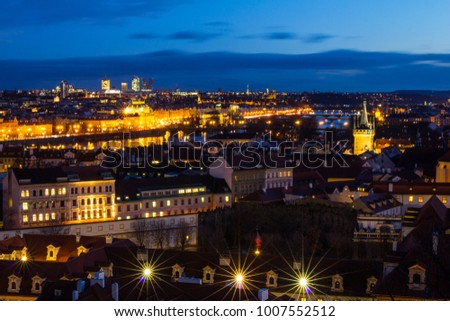 Beautiful Night view over the Vltava river, Charles bridge, the embankment Smetanovo, tower old city, Church St. Assisi and whole Prague. Popular European travel destination. Chech Republic. #1007552512