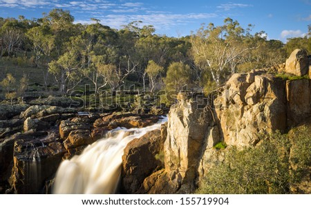 Beautiful Nigretta Falls waterfall in Western Victoria, Australia with high flow during winter time in time-lapse Stock photo ©