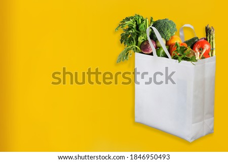 Beautiful Non Woven grocery shopping bag with yellow background Stockfoto ©