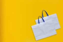 Beautiful Non Woven grocery shopping bags with yellow background