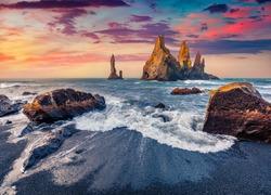 Beautiful Nordic scenery. Captivating morning seascape of Atlantic ocean. Stunning summer sunrise on Reynisdrangar cliffs. Colorful summer scene of Iceland, Vik location, Europe.