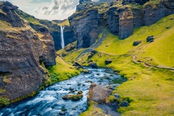 Beautiful Nordic scenery. Fresh green grass on the hills on Kvernufoss watterfall. Gorgeous summer view of pure water river in Iceland, Europe. Beauty of nature concept background.