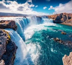 Beautiful Nordic scenery. Gorgeous summer scene of Skjalfandafljot river, Iceland, Europe. Exciting morning view of Godafoss, spectacular waterfall plunging over a curved, 12m-high precipice.