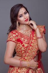 beautiful North Indian female model wearing jewellery, indoor lighting