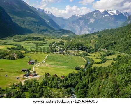 Beautiful Norwegian nature, mountains, roads and mountain river. Mountain village