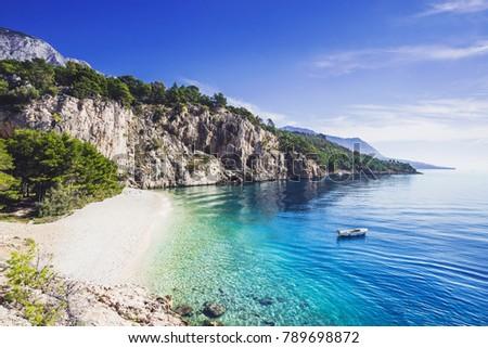 Beautiful Nugal beach near Makarska town, Dalmatia, Croatia. Makarska riviera, famous landmark and travel touristic destination in Europe #789698872
