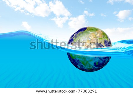 Beautiful ocean with view of sand underwater and floating earth. concepts for global warming. Data Source: NASA - stock photo