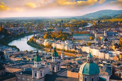 Beautiful of Aerial panoramic view in a Autumn season at a historic city of Salzburg with Salzach river in beautiful golden evening light sky and colorful of autumn at sunset, Salzburger Land, Austria