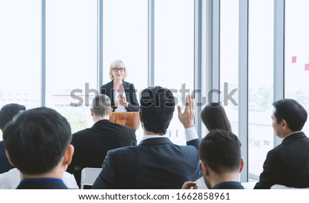Beautiful of business woman is speaking on conference. Seminar of business model and inspiration concept with the audience put hand up to ask the question from topic.