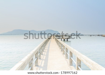 Beautiful of view concrete pier into the sea.
