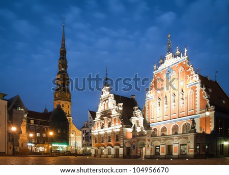 Beautiful old architecture of the central square of Riga. Night view with blue cloudy sky in background and illuminated buildings in foreground. Riga, Latvia, Baltic, Europe.