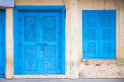 Beautiful old blue gates. Indian architecture.