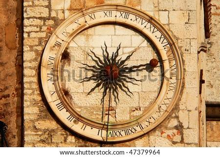 stock-photo-beautiful-old-clock-tower-in-the-sun-47379964.jpg
