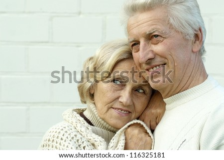 beautiful old couple standing on a light background