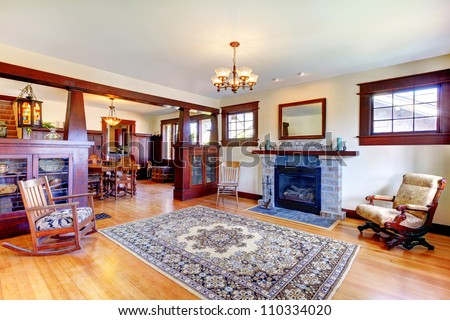 Beautiful old craftsman style home living room interior with fireplace.