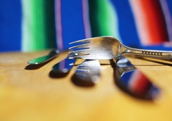 beautiful old cutlery set, dessert fork and knives on the colourful background