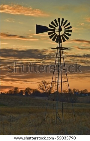 Beautiful Old Farm Windmill for Pumping Water at Sunset