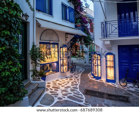 Beautiful old, narrow alley with cobblestone in Skiathos, Greece
