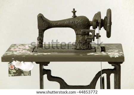 Beautiful old sewing machine in a white background