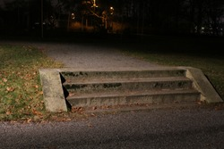 Beautiful old stone stairs in the park at night.