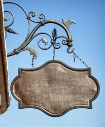 beautiful old store sign in front of sky