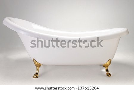 Beautiful old style white bath tub with gold feet