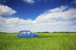 Beautiful old vintage car on a green meadow
