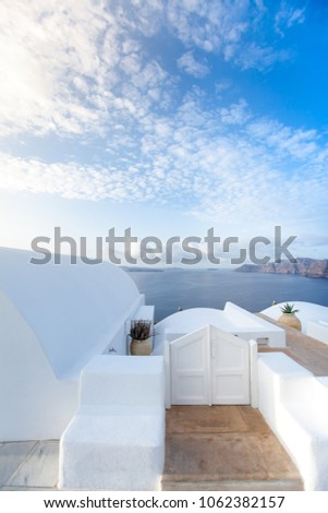 Beautiful old white ortodox church in sunny day with blue sky in Oia on Santorini island. Santorini is romantic place, one of the most visited Greek islands #1062382157