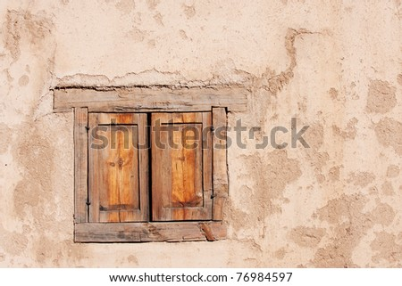 Beautiful old window in historical adobe, Taos, NM