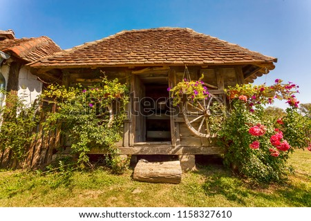 Beautiful old wooden Serbian house in Vrdnik with flowers outdoors #1158327610