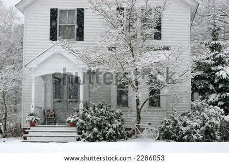 beautiful older home in snow