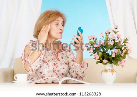 Beautiful older woman resting in the bedroom after a hard working week