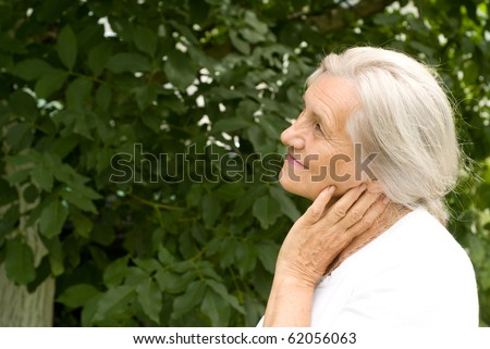 beautiful older woman stands on the green