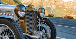 Beautiful oldtimer car spotted at the famous Grossglockner High Alpine Road, Salzburg, Austria