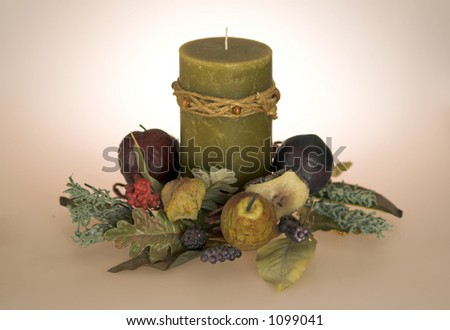 beautiful olive candle with fruit base
