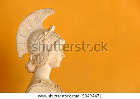 Beautiful orange background with antic Hellenic bust - stock photo