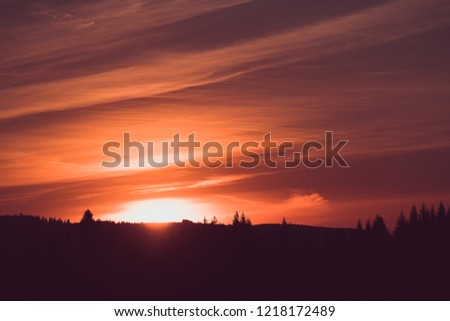 Beautiful orange dawn over the mountains during summer #1218172489