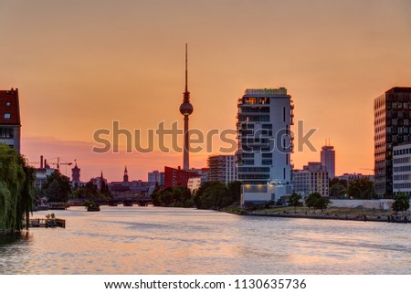 Beautiful orange sky at sunset over Berlin with the famous Television Tower