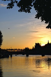 Beautiful orange sunset at the river Seine in Paris France