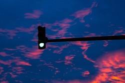 Beautiful orange sunset at traffic light