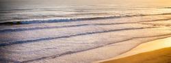 Beautiful orange sunset on the ocean shore. long wide banner