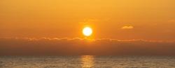 Beautiful orange sunset over the calm sea.