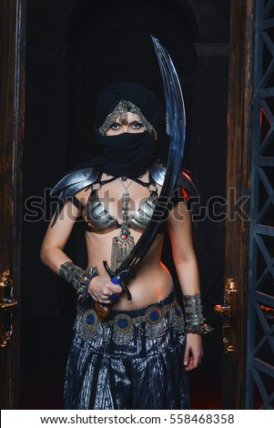Stock Photo Beautiful oriental girl warrior in armor with a sword