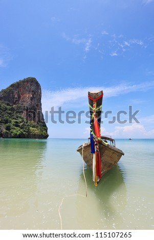 Beautiful, ornate antique boat Longtail on a beach in Thailand