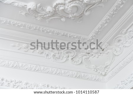Beautiful ornate white decorative plaster moldings in studio #1014110587