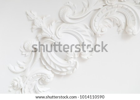 Beautiful ornate white decorative plaster moldings in studio #1014110590