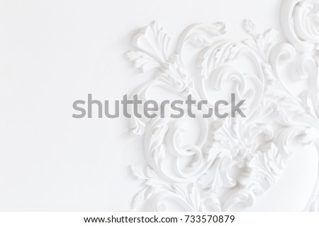 Beautiful ornate white decorative plaster moldings in studio #733570879